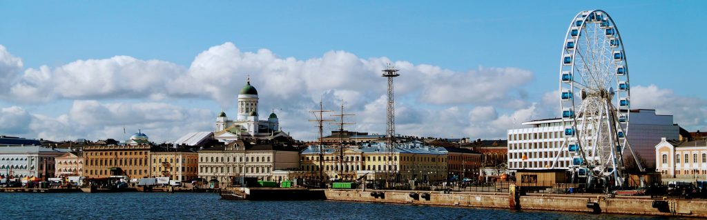 From the view of a boat entering Helsinki harbor, looking out to Helsinki Cathedral and the SkyWheel.